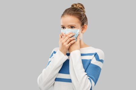 teenage girl in protective medical mask