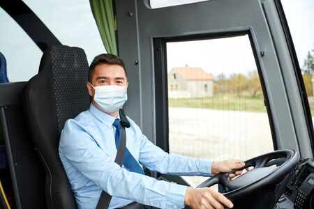 driver in medical mask driving intercity bus
