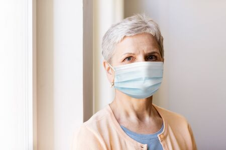 senior woman in protective medical mask