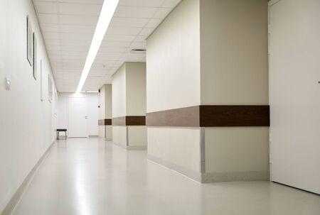 healthcare, medicine and ambulatory concept - empty hospital corridor