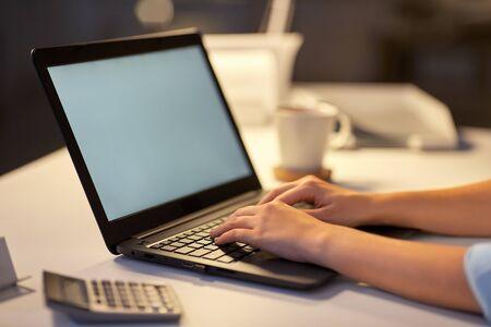 businesswoman with laptop at dark night office