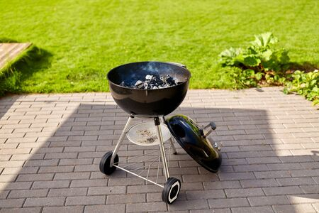charcoal smoldering in brazier outdoors