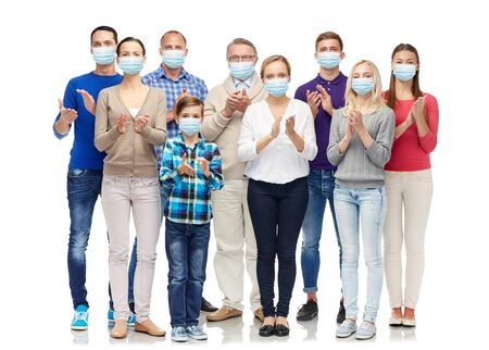 people in medical masks applauding