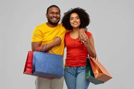 happy african american couple with shopping bags