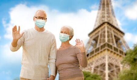 old couple in protective medical masks in france
