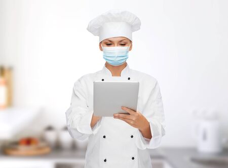 female chef in face mask with tablet pc computer