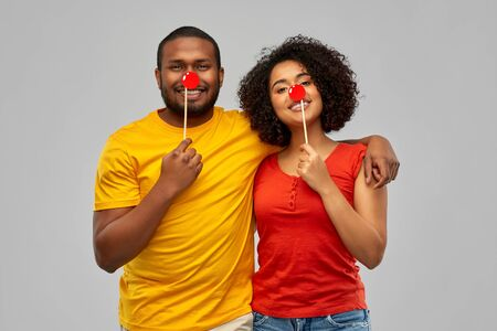 happy african american couple with red clawn noses Stock Photo