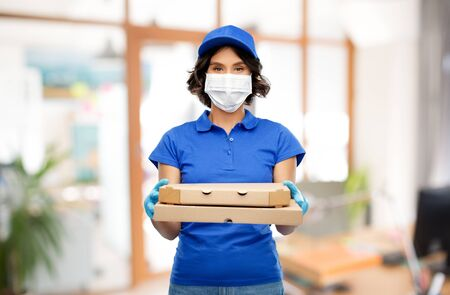 delivery woman in mask with pizza boxes at office