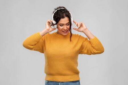 happy woman in headphones listening to music