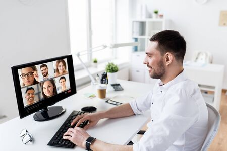 businessman has video call with partners at office