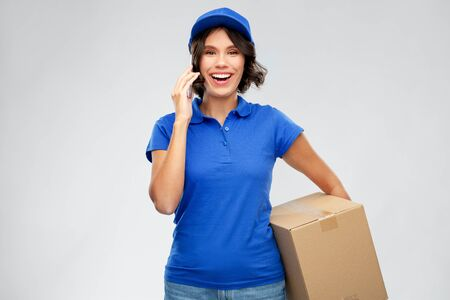 delivery girl with parcel box calls on smartphone
