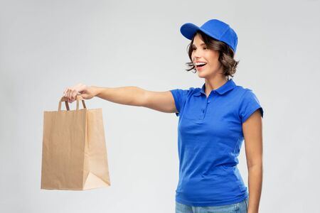 delivery woman with takeaway food in paper bag