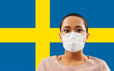 woman in protective mask over flag of sweden