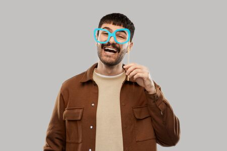 happy smiling man with glasses party accessory