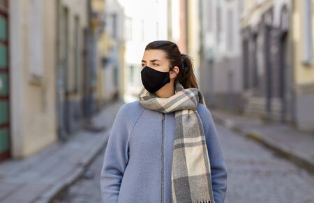 woman wearing protective reusable barrier mask