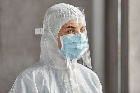 doctor in protective wear, mask and face shield Reklamní fotografie