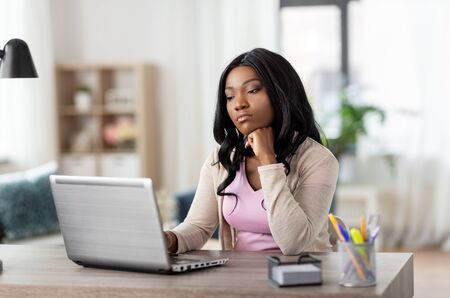 bored woman with laptop working at home office