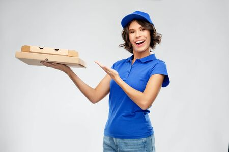 delivery woman with takeaway pizza boxes