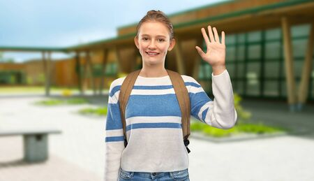 smiling teenage student girl with school bag