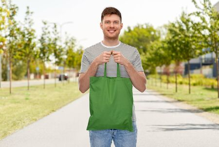man with reusable canvas bag for food shopping Stock Photo