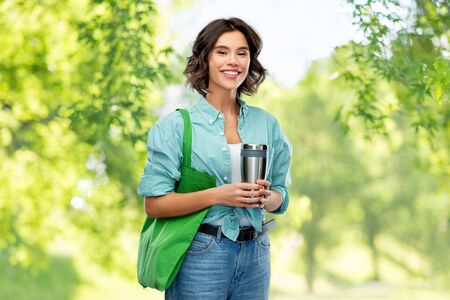 woman with bag for food shopping and tumbler