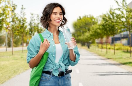woman with bag for food shopping and glass bottle Stock Photo