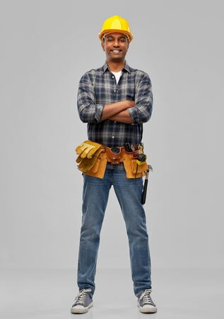 happy indian worker or builder with crossed arms Stock Photo
