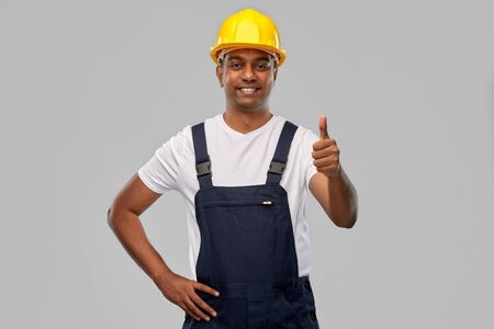 happy indian worker or builder showing thumbs up