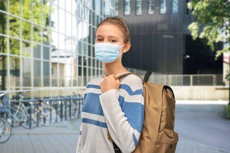 teenage student girl with school bag Фото со стока