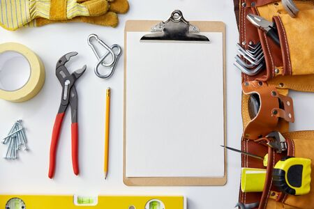 clipboard with white paper, pencil and work tools