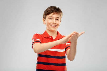 portrait of happy smiling boy applauding