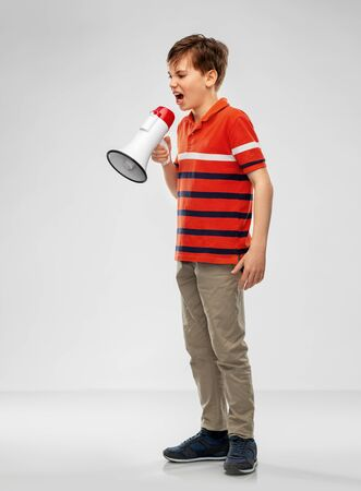 angry boy speaking to megaphone Stock Photo