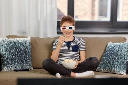 boy in 3d movie glasses and watching tv at home