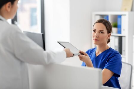 doctor and nurse with tablet computer at hospital Stock Photo