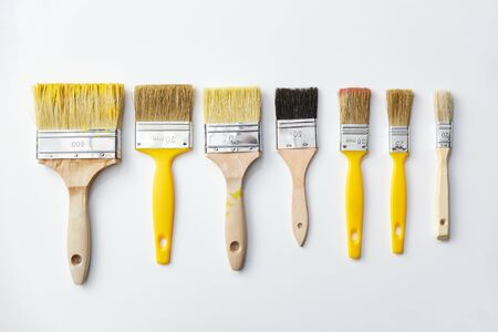 different size paint brushes on white background