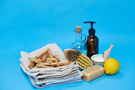 baking soda, lemon, brush, vinegar and clothespins