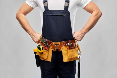 worker or builder in overall with working tools