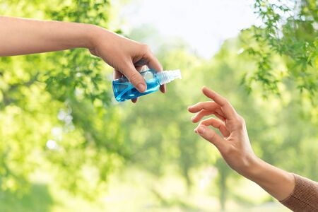 close up of hands giving each other gel sanitizer