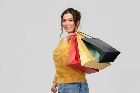 happy smiling young woman with shopping bags Standard-Bild