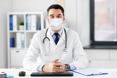 male doctor in medical mask at hospital