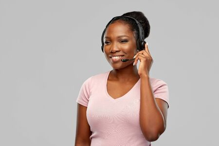 african american woman in headset with microphone