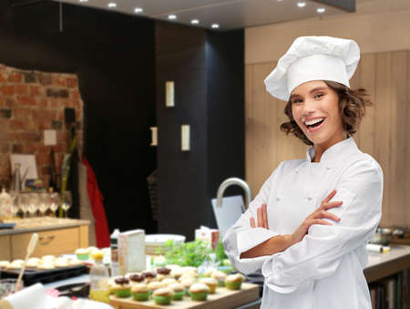 female chef with crossed arms over restaurant