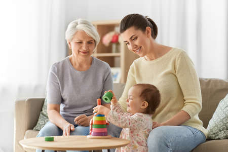 mother, baby daughter and granny playing at home Imagens