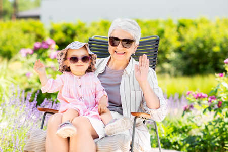 happy grandmother and baby granddaughter at garden