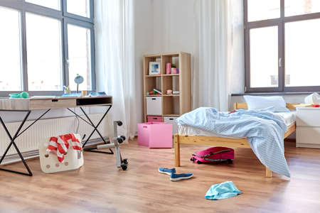 messy home or kids room with scattered stuff
