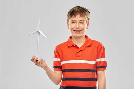 happy smiling boy holding toy wind turbine