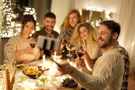 friends taking selfie at christmas dinner party