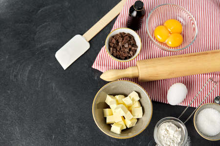 rolling pin, butter, eggs, flour and chocolate