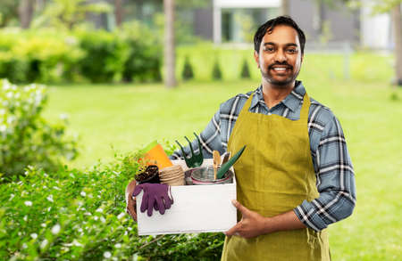 indian gardener or farmer with box of garden tools