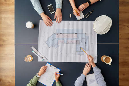 business team with blueprint working at office Stock fotó